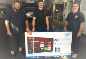 Left to right: Jason Dacosta, Zac Dacosta and Derek Dacosta of Federated Car Care Center Dacosta's Auto World in Fairfield, California, with the 55-inch television they won at the Vaca Valley Auto Parts customer appreciation barbeque. Derek is the owner, Jason is his son and Zac is his grandson.