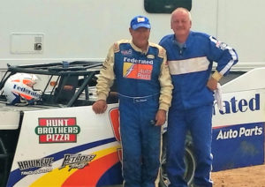"For the second year in a row, Federated Auto Parts member Parts Distributing Inc. hosted a ""Get Dirty with Kenny"" event for 20 of its top customers last month at Plymouth Dirt track in Plymouth, Wisconsin. PDI has been a Federated Auto Parts member proudly serving Southeastern Wisconsin for over 23 years. Left to Right: Kenny Schrader and Darrel T. Radmer; Darrel's Transmission & Engine Repair of Waukesha, Wisconsin."