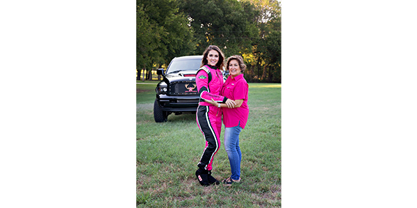 "Racecar driver Amalee Mueller, posing with her mom – a breast cancer survivor, partnered with Hot Shot's Secret through her ""Save the Racks"" campaign to raise a contribution of $5,950 to the Breast Cancer Research Foundation."