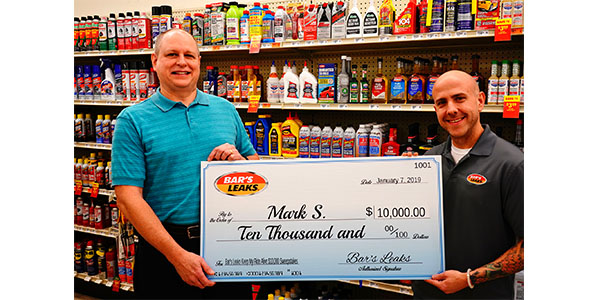 Bar's Leaks' Bobby Janiec (right) visited the O'Reilly Auto Parts in Waterloo, Illinois, to present Mark S. with a check for winning the Bar's Leaks $10,000 Keep My Ride Alive Sweepstakes.