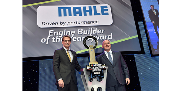 Doug Yates (left), of Roush Yates Engines accepts the MAHLE Engine Builder of the Year Award for the Monster Energy NASCAR Cup Series and for the NASCAR Xfinity Series from Ted Hughes (right), manager – marketing, MAHLE Aftermarket.