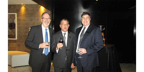 Steve Sigg, Chuck Hise and Stan Gowisnok, all of CARDONE, toast to a great evening in Miami.