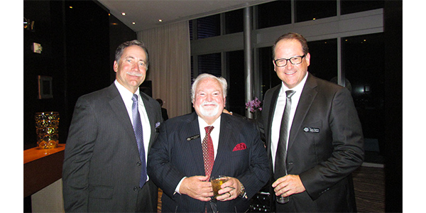 John Washbish, center, was the keynote speaker for the NPW Million Dollar Vendor dinner. Here, he chats with attendees from Federal-Mogul during the cocktail reception.