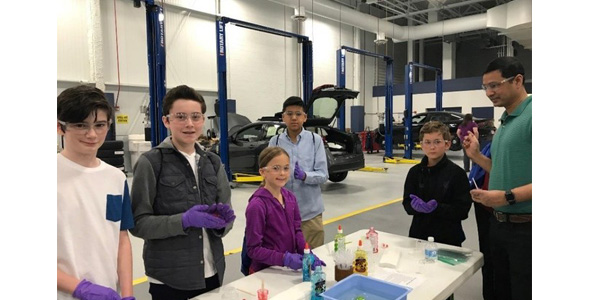 """Children participate in a science experiment during BorgWarner's 2018 """"Take Our Daughters and Sons to Work Day"""" event. The event gives kids the opportunity to not only job shadow their parent in the workplace, including both office and laboratory settings, but also to participate in interactive science, technology, engineering and math (STEM) activities."""