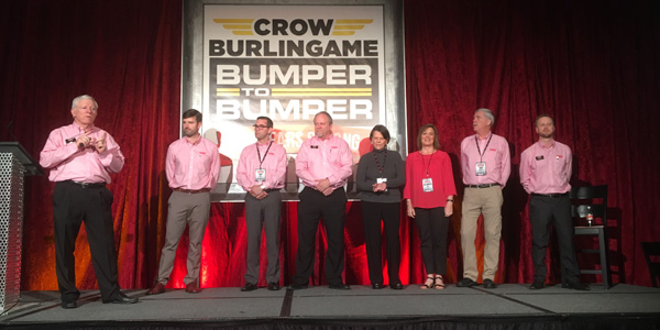 Bill Schlatterer, president and CEO of Crow-Burlingame (left), announces leadership changes during the company's centennial celebration in Little Rock, Arkansas.