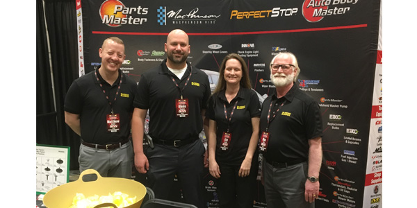 From left to right, Matthew Butler, Blake Thomas, Kim Smith and Max Dull take part in the vendor show at Crow-Burlingame's centennial celebration and joint business conference with Bumper to Bumper.