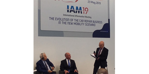 """Bill Hanvey (center), president and CEO of the Auto Care Association, listens to a panelist while participating in the """"The Evolution of the Car Repair Business in the New Mobility Scenario"""" AutopromotecEDU program in Bologna."""