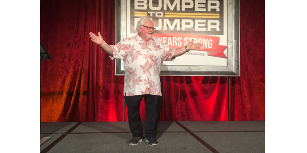 """During Crow-Burlingame's centennial celebration in Little Rock, Arkansas, John R. Washbish, president of the Aftermarket Auto Parts Alliance, offers congratulations on behalf of Bumper to Bumper and leads attendees in a game of """"Kahoot."""""""