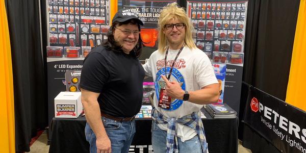 "Mark Assenmacher (left) and Matthew Altenhofen of Peterson Manufacturing Co. transform into ""Wayne"" and ""Garth"" from ""Wayne's World"" at Crow-Burlingame's centennial celebration in Little Rock, Arkansas."