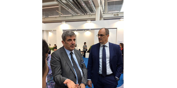 Renzo Servadei, CEO of Autopromotec, chats on the show floor.