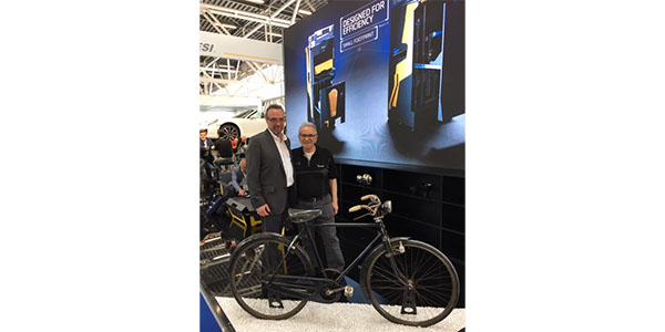 At Autopromotec 2019, Tim Morgan, COO and managing director of Spanesi Americas, and  Orazio Spanesi, founder of the company, show off a bicycle that was given to Orazio 50 years ago by a body shop owner so he could get to and from work.