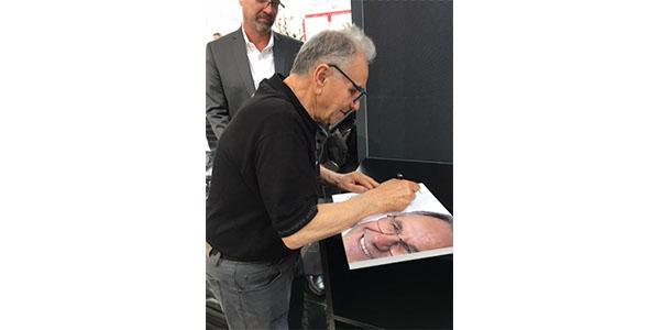 Spanesi founder Orazio Spanesi signs a book on his extraordinary life at Autopromotec 2019.