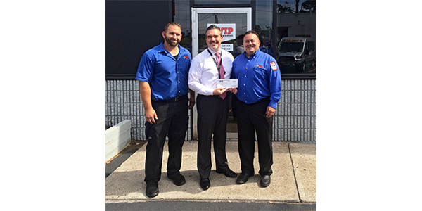 VIP Tires & Service recently raised $4,930 for local Framingham area schools through its $10 Oil Change promotion.  (L to R): Michael Escolas, VIP Framingham Store Manager; Dr. Robert Tremblay, Framingham Superintendent of Schools; Anthony Cierie, VIP District Manager