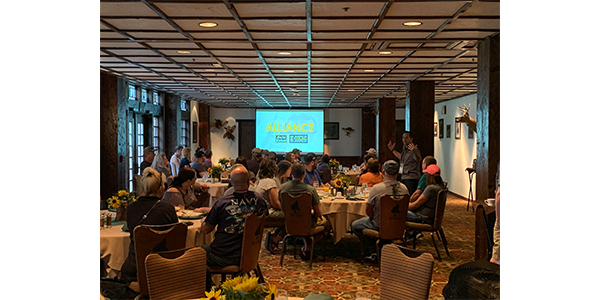 JC Washbish, Vice President of Sales and Marketing for the Aftermarket Auto Parts Alliance, Inc., addressed Ultimate Outdoor Adventure grand prize winners during an orientation breakfast in Branson, Mo. on Oct. 3, 2019.