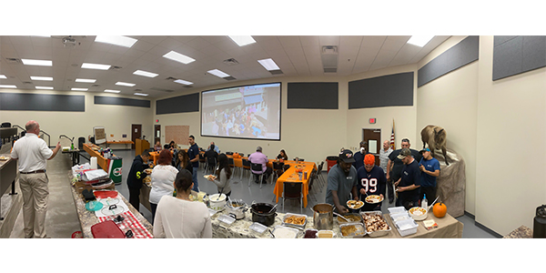 Arnold Oil of Austin employees gather to feast and celebrate together.