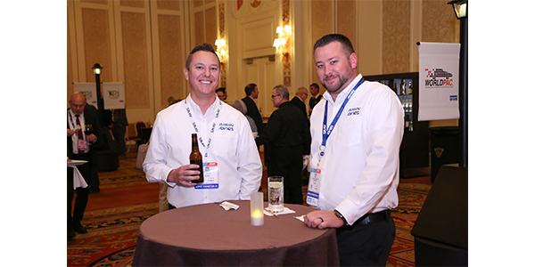 Execs from Advics enjoy a cold one at an AAPEX networking event.