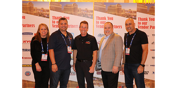 At center driver Clay Millican with David Prater and crew at The Network's AAPEX reception.
