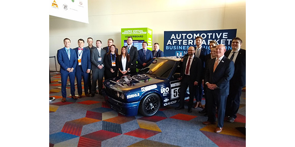 Far right AASA's Paul McCarthy and Bill Harvey of the Auto Care Association pose with Northwood's Aftermarket Club and their project car at AAPEX.